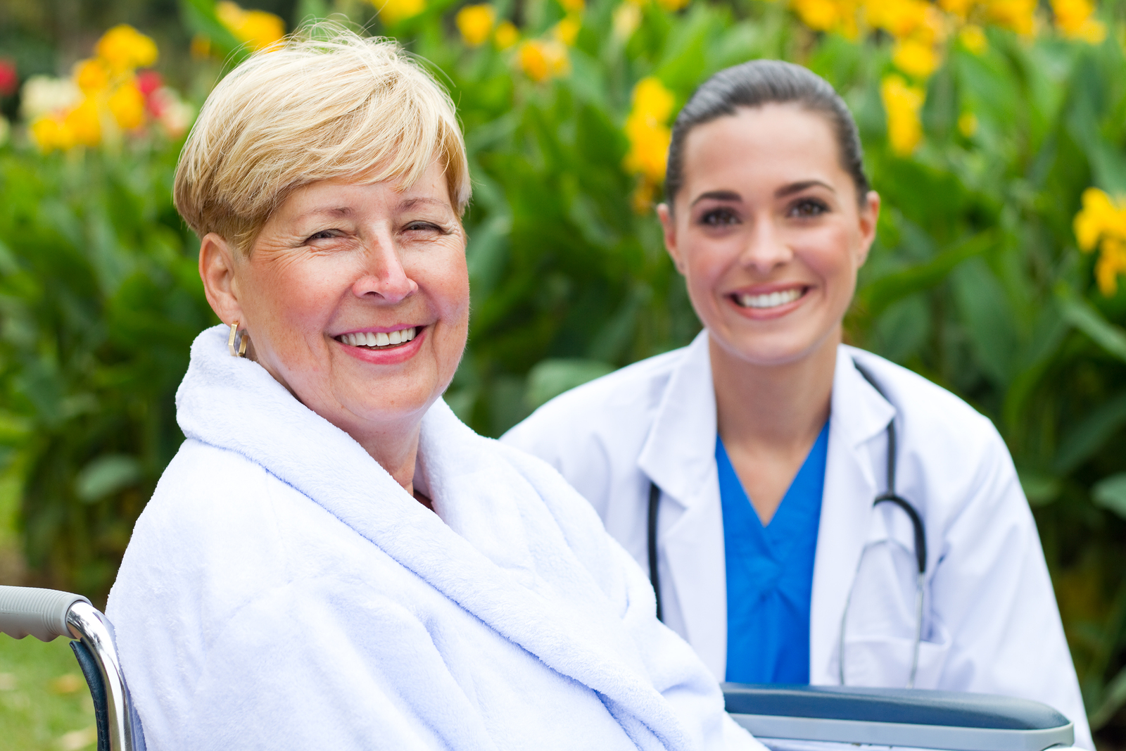 female patient and doctor outdoors and smiling