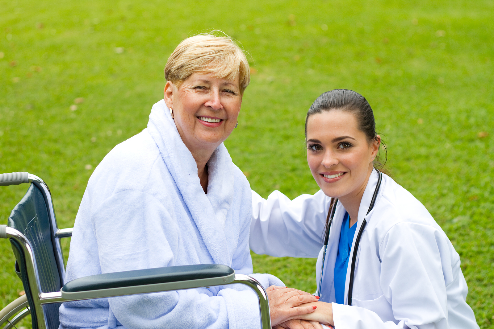 private nurse and happy patient in park